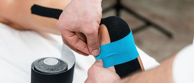 hielspoor tapen met kinesiotape of medical tape